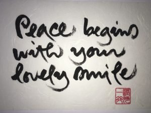 Peace begins with your lovely smile calligraphy by Thich Nhat Hanh